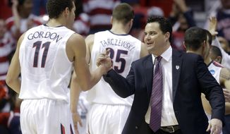 Arizona head coach Sean Miller, right, greets Arizona forward Aaron Gordon, left, as he leaves the game during the second half of a third-round game in the NCAA college basketball tournament Sunday, March 23, 2014, in San Diego. Arizona won, 84-61. (AP Photo/Lenny Ignelzi)