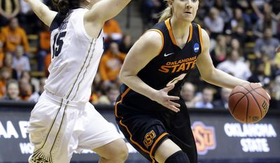 Oklahoma State forward Liz Donohoe, right, drives on Purdue guard Courtney Moses during the first half of a women's second round NCAA tournament college basketball game in West Lafayette, Ind., Monday, March 24, 2014.  (AP Photo/Michael Conroy)