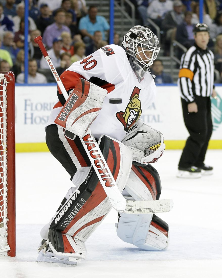 Ottawa Senators goalie Robin Lehner (40) makes a blocker save on a shot by the Tampa Bay Lightning during the second period of an NHL hockey game Monday, March 24, 2014, in Tampa, Fla. (AP Photo/Chris O'Meara)