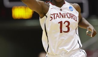 Stanford's Chiney Ogwumike (13) celebrates a point in the first half of a second-round game against Florida State in the NCAA women's college basketball tournament in Ames, Iowa, Monday, March 24, 2014. (AP Photo/Nati Harnik)