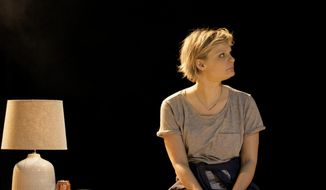 """In this photo taken in March 2014 and released by The Old Vic Theatre, Martha Plimpton appears as Brooke Wyeth in the Old Vic Theatre production of """"Other Desert Cites"""" in London. The Emmy Award-winning Martha Plimpton is making her West End stage debut in Jon Robin Baitz's """"Other Desert Cities,"""" an excoriating family drama about the implosion of a wealthy clan of Reaganesque California Republicans. (AP Photo/Johan Persson, The Old Vic Theatre)"""
