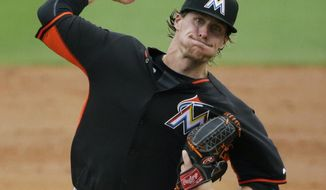Miami Marlins starting pitcher Tom Koehler throws in the second inning of an exhibition spring training baseball game against the Washington Nationals, Monday, March 24, 2014, in Jupiter, Fla. (AP Photo/David Goldman)