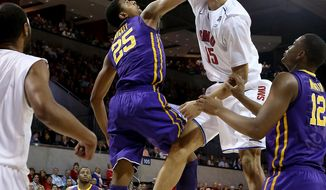 SMU Mustangs center Cannen Cunningham (15) dunks on LSU Tigers forward Jordan Mickey (25) in the first half of NIT Men's Basketball Tournament Second Round action at Moody Coliseum in University Park, Texas on Monday, March 24, 2014.  (AP Photo/The Dallas Morning News, Brad Loper )  MANDATORY CREDIT; MAGS OUT; TV OUT; INTERNET USE BY AP MEMBERS ONLY; NO SALES