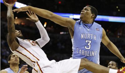 Iowa State guard DeAndre Kane (50) tries to shoot as North Carolina forward Kennedy Meeks (3) defends during the second half of a third-round game in the NCAA college basketball tournament Sunday, March 23, 2014, in San Antonio. (AP Photo/David J. Phillip)