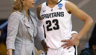 Michigan State head coach Suzy Merchant, left, talks with player Aerial Powers during the second half against Hampton of a first-round game of the NCAA women's college basketball tournament, Sunday, March 23, 2014, in Chapel Hill, N.C. Michigan State won 91-61. (AP Photo/Ellen Ozier)