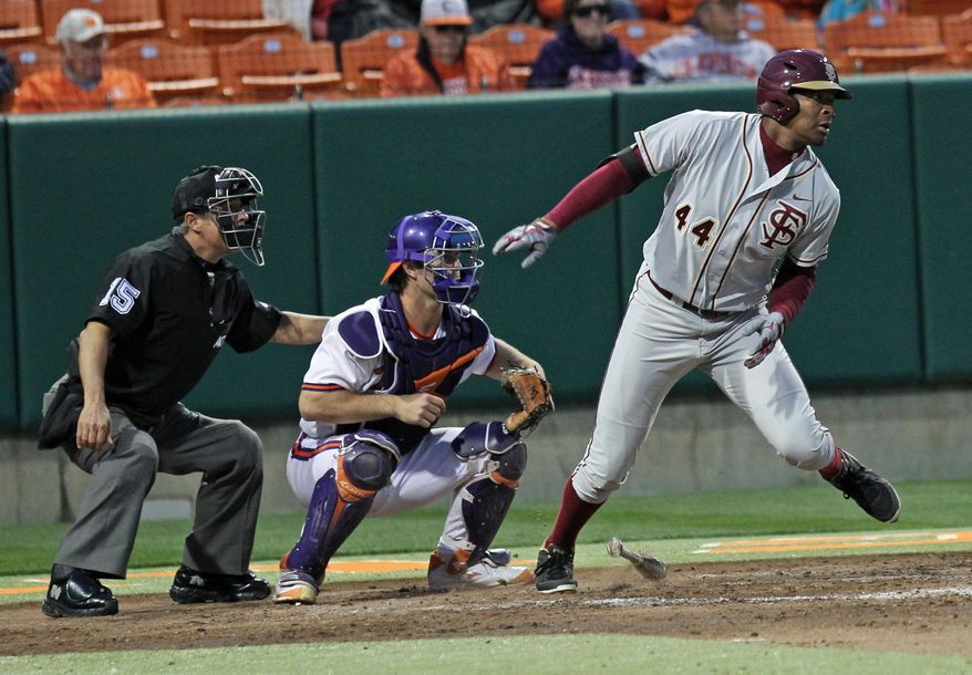 Home plate umpire A.J. Lostaglio, Clemson catcher Garrett Boulware and Florida State batter Jameis Winston watch Winston's RBI double during an NCAA college baseball game Friday, March 21, 2014, in Clemson, S.C. (AP Photo/Anderson Independent-Mail, Mark Crammer) SENECA OUT  GREENVILLE OUT