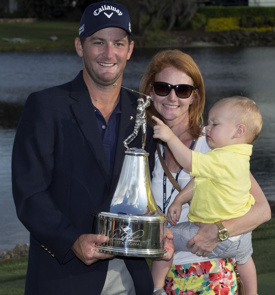 Matt Every, left, his wife Danielle and their son Liam pose with the trophy after the Arnold Palmer Invitational golf tournament at Bay Hill, Sunday, March 23, 2014, in Orlando, Fla. (AP Photo/Willie J. Allen Jr.)