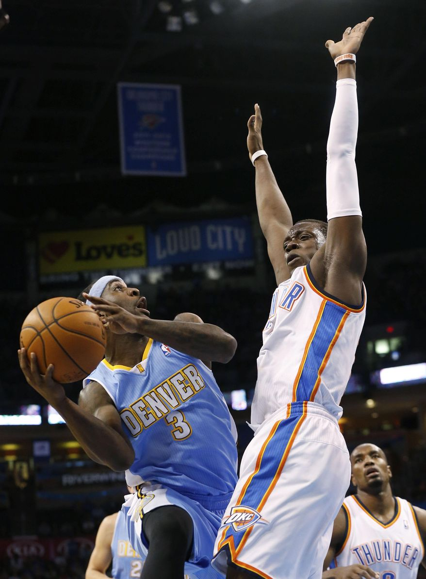 Denver Nuggets guard Ty Lawson (3) shoots as Oklahoma City Thunder guard Reggie Jackson (15) defends in the first quarter of an NBA basketball game in Oklahoma City, Monday, March 24, 2014. (AP Photo/Sue Ogrocki)