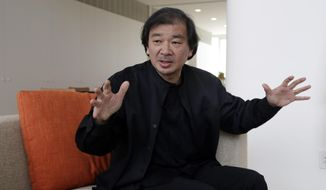 This March 20, 2014 photo shows Tokyo-born architect Shigeru Ban, 56, the recipient of the 2014 Pritzker Architecture Prize, in New York. (AP Photo/Richard Drew)