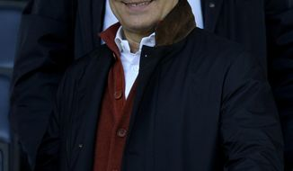 Italy coach Cesare Prandelli smiles in the stands prior to the Serie A soccer match between Parma and Genoa at Parma's Tardini stadium, Italy, Sunday, March 23, 2014. (AP Photo/Marco Vasini)