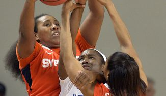 Kentucky's Linnae Harper, center, battles Syracuse' Shakeya Leary, left, and Cornelia Fondren for a loose ball during the second half of a second-round game in the NCAA college basketball tournament in Lexington, Ky., Monday, March 24, 2014. Kentucky defeated Syracuse 64-59. (AP Photo/Timothy D. Easley)