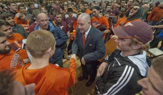 Virginia Tech's new men's head basketball coach, Buzz Williams, meets fans after an introductory press conference held at Cassell Coliseum, in Blacksburg, Virginia, Monday, March 24, 2014. (AP Photo/Roanoke Times, Don Petersen)