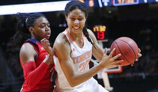 Tennessee center Isabelle Harrison (20) drives against St. John's forward Amber Thompson, left, in the first half of an NCAA women's college basketball second-round tournament game Monday, March 24, 2014, in Knoxville, Tenn. (AP Photo/John Bazemore)