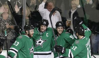 Dallas Stars center Tyler Seguin (91) celebrates scoring his goal with teammates  Alex Goligoski (33), Jamie Benn (14) and Alex Chiasson (12) during the second period of an NHL hockey game against the Winnipeg Jets Monday, March 24, 2014, in Dallas. (AP Photo/LM Otero)