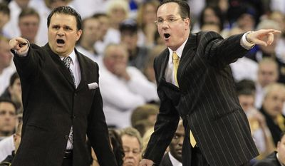 FILE - In this March 2, 2013 file photo, Wichita State head coach Gregg Marshall, right, and associate head coach Chris Jans, left, yell instructions in the first half of an NCAA college basketball game against Creighton in Omaha, Neb. Bowling Green State University has hired Jans as its new head coach, replacing the fired Louis Orr.  Jans has been Wichita State's associate head coach since 2011-12.  (AP Photo/Nati Harnik, File)