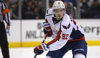 Washington Capitals center Evgeny Kuznetsov, of Russia, moves the puck during the third period of an NHL hockey game against the Los Angeles Kings, Thursday, March 20, 2014, in Los Angeles. The Kings won 2-1 in an overtime shootout. (AP Photo/Mark J. Terrill)