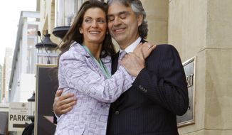 FILE - This March 2, 2010 file photo shows Italian tenor Andrea Bocelli, right, and Veronica Berti pose at the dedication ceremonies for his new star on the Hollywood Walk of Fame in Los Angeles. Reps for Bocelli announced Monday, March 24, 2014, that Bocelli and his companion Veronica Berti married on March 21. (AP Photo/Reed Saxon, File)