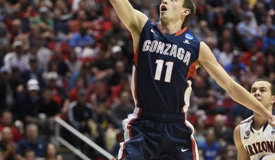Gonzaga guard David Stockton (11) shoots while playing Arizona during the first half of a third-round game in the NCAA college basketball tournament Sunday, March 23, 2014, in San Diego. (AP Photo/Denis Poroy)