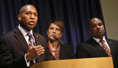 """Associate United States Attorney General Tony West, flanked by US Attorney for the Southern District of California Laura Duffy and COPS Office Director Ron Davis, talks about the federal investigation into the San Diego Police Department at a news conference Monday, March 24, 2014, in San Diego.  The city said in a statement Sunday that the investigation was an attempt to restore transparency and was """"the first of many steps to help rebuild the San Diego Police Department."""" (AP Photo/Lenny Ignelzi)"""