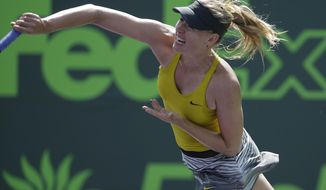 Maria Sharapova, of Russia, serves to Kirsten Flipkens, of Belgium, at the Sony Open tennis tournament, Monday, March 24, 2014, in Key Biscayne, Fla. (AP Photo/Lynne Sladky)