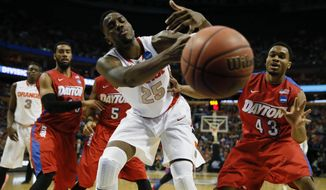 Syracuse's Rakeem Christmas (25) can't hang on to a rebound under pressure from Dayton's Vee Sanford (43) during the third-round game in the men's NCAA college basketball tournament at the First Niagara Center, Saturday, March 22, 2014. (AP Photo/The Buffalo News, Harry Scull Jr)