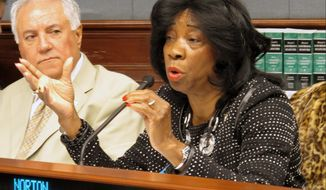Rep. Barbara Norton, D-Shreveport, speaks against a bill that would ban hand-held cell phone use while driving, during a House Transportation Committee hearing on Monday, March 24, 2014, in Baton Rouge, La. The bill's sponsor shelved the proposal after facing opposition from the committee. (AP Photo/Melinda Deslatte)