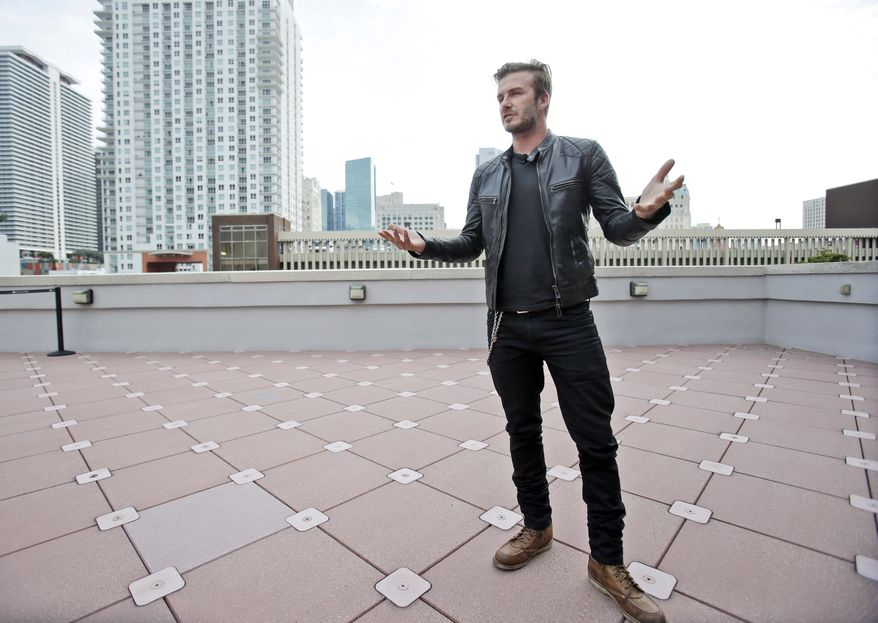 David Beckham speaks during a news conference, Monday, March 24, 2014 in Miami. Beckham's architects and advisers have recommended the Port of Miami as the stadium site for the Major League Soccer expansion team that will be owned by the former English national team captain. The plan announced Monday would have an open-air stadium with views of the bay and the downtown skyline. The capacity could be as low as 21,000 or as high as 35,000. (AP Photo/Wilfredo Lee)