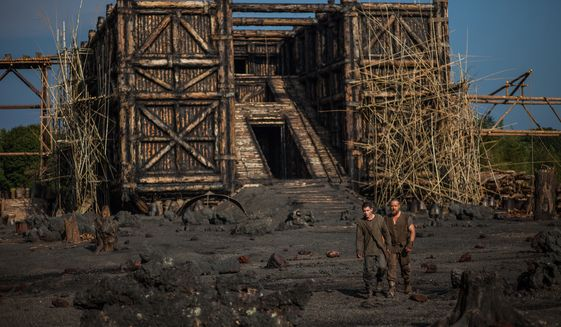 """This image released by Paramount Pictures shows Logan Lerman, left, and Russell Crowe in a scene from """"Noah."""" (AP Photo/Paramount Pictures, Niko Tavernise)"""