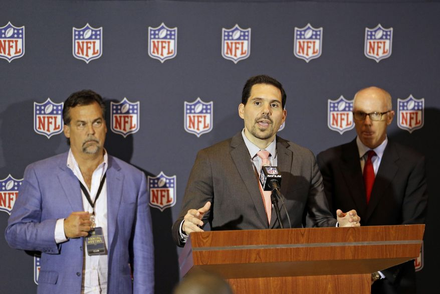 NFL vice president of officiating Dean Blandino, center, answers questions during a news conference, while Atlanta Falcons President & CEO and NFL competition committee member Rich McKay, back right, and Jeff Fisher, head coach of the St. Louis Rams and member of the NFL competition committee listen, at the NFL football annual meeting in Orlando, Fla., Monday, March 24, 2014. (AP Photo/John Raoux)