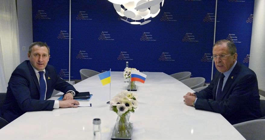 Russia's Foreign Minister Sergey Lavrov, right, meets with Ukrainian Foreign Minister Andriy Deshchytsia at the Nuclear Security Summit (NSS) in The Hague, Netherlands, Monday, March 24, 2014. Nuclear terrorism is officially the main topic for world leaders at a two-day summit in the Netherlands, in practice, the Ukraine crisis overshadows those talks. (AP Photo)