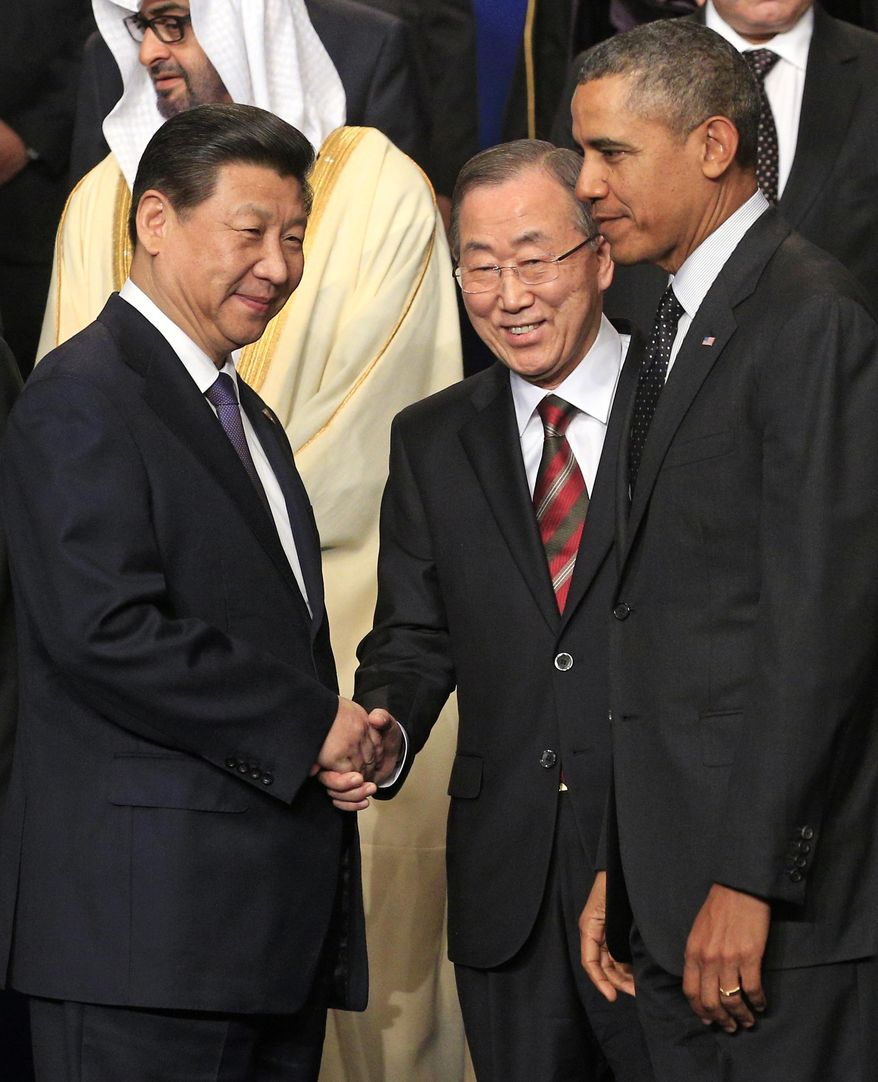 U.S. President Barack Obama, right, China's President Xi Jinping, left, and U.N. Secretary General Ban Ki-moon, center, walk away after they posed for a group photo, on the last day of the Nuclear Security Summit (NSS) in The Hague, Netherlands, Tuesday, March 25, 2014. (AP Photo/Yves Logghe)
