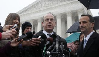 Paul Clement, attorney for Hobby Lobby and Conestoga Wood, center, stands with attorney David Cortman, right, as they speak to reporters in front of the Supreme Court in Washington, Tuesday, March 25, 2014, after the court heard oral arguments in the challenges of President Barack Obama's health care law requirement that businesses provide their female employees with health insurance that includes access to contraceptives. Supreme Court justices are weighing whether corporations have religious rights that exempt them from part of the new health care law that requires coverage of birth control for employees at no extra charge. (AP Photo/Charles Dharapak)