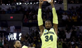 Baylor's Cory Jefferson (34) dunks the ball against Nebraska during the second half of a second-round game in the NCAA college basketball tournament Friday, March 21, 2014, in San Antonio. Baylor won 74-60. (AP Photo/David J. Phillip)
