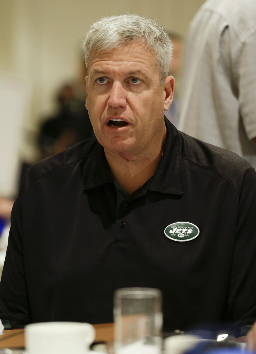 New York Jets head coach Rex Ryan talks with reporters during the AFC head coaches breakfast at the NFL football annual meeting in Orlando, Fla., Tuesday, March 25, 2014. (AP Photo/John Raoux)