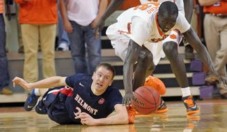 Belmont's Craig Bradshaw, left, and Clemson's Ibrahim Djambo chase after a loose ball during the first half of their NCAA college basketball National Invitational Tournament game at Littlejohn Coliseum in Clemson, S.C., on Tuesday, Mar. 25, 2014. (AP Photo/Anderson Independent-Mail, Mark Crammer)