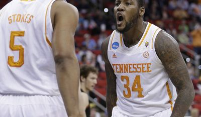 Tennessee forward Jeronne Maymon (34) reacts to Jarnell Stokes' (5) goal during the second half of an NCAA college basketball third-round tournament game against Mercer, Sunday, March 23, 2014, in Raleigh. (AP Photo/Chuck Burton)