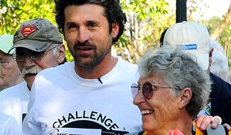 FILE - This Oct. 8, 2011 file photo shows actor Patrick Dempsey participating in the Survivor Walk with his mother, Amanda, right, in Lewiston, Maine, on the first day of the Dempsey Challenge. Amanda Dempsey, who inspired her son, actor Patrick Dempsey, to help create a cancer support organization at Central Maine Medical Center in Lewiston, died of cancer on Monday, March 24, 2014 at age 79. (AP Photo/Sun Journal, Amber Waterman) MAGS OUT; TV OUT; MANDATORY CREDIT