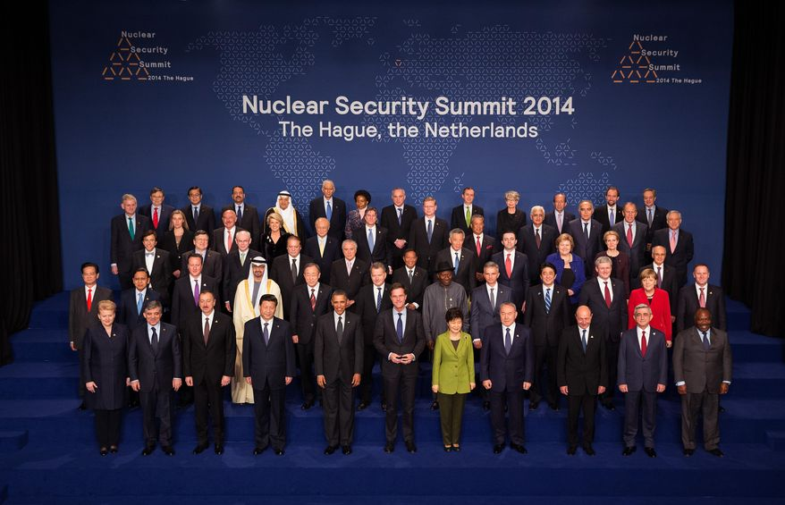 President Barack Obama poses during the family photo at the Nuclear Security Summit, Tuesday, March, 25, 2014, in The Hague, The Netherlands.  (AP Photo/Doug Mills, Pool)