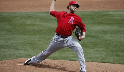 Los Angeles Angels pitcher Brandon Lyon throws against the Chicago Cubs' during the second inning of a spring training baseball game, Tuesday, March 25, 2014, in Mesa, Ariz. (AP Photo/Matt York)