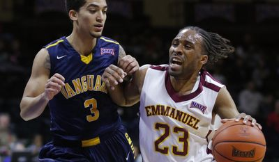 Emmanuel guard Michael Stanley (23) drives on Vanguard guard Chris Gorman (3) during the first half of an NAIA college basketball game and finals of the men's national championship tournament in Kansas City, Mo., Tuesday, March 25, 2014. (AP Photo/Orlin Wagner)