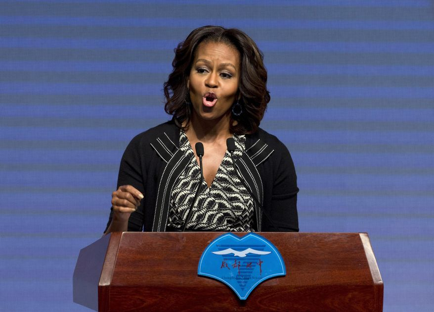U.S. first lady Michelle Obama delivers a speech at Chengdu No. 7 High School in Chengdu in the southwestern province of Sichuan, China Tuesday, March 25, 2014. Obama spoke to rural Chinese students via web conferencing Tuesday, at her last stop of the six-day China tour focusing on education and cultural exchange. (AP Photo/Andy Wong)