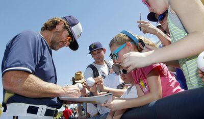 Milwaukee Brewers special instructor Robin Yount signs autographs for fans prior to a spring training baseball game against the San Francisco Giants, Tuesday, March 25, 2014, in Phoenix. (AP Photo/Ross D. Franklin)
