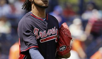 Atlanta Braves starting pitcher Ervin Santana tosses the ball to first base after fielding a ground out by New York Mets' Chris Young in the second inning of an exhibition spring training baseball game, Thursday, March 20, 2014, in Port St. Lucie, Fla. (AP Photo/David Goldman)