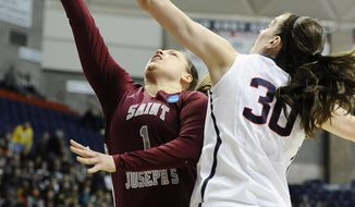 Connecticut's Breanna Stewart, right, blocks a shot attempt by Saint Joseph's Ilze Gotfrida, left, during the first half of a second-round game of the NCAA women's college basketball tournament, Tuesday, March 25, 2014, in Storrs, Conn. (AP Photo/Jessica Hill)
