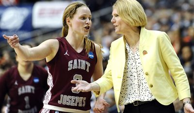Saint Joseph's Erin Shields, left, speaks with head coach Cindy Griffin during the first half of a second-round game of the NCAA women's college basketball tournament, Tuesday, March 25, 2014, in Storrs, Conn. (AP Photo/Jessica Hill)