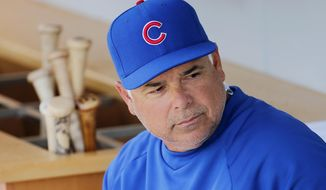 Chicago Cubs manager Rick Renteria sits on the bench during the first inning of a spring training baseball game against the Los Angeles Angels, Tuesday, March 25, 2014, in Mesa, Ariz. (AP Photo/Matt York)