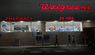 FILE - In this June 21, 2013, file photo, customers leave a Walgreens pharmacy in Jackson, Miss. Walgreen Co. reports quarterly financial results, Tuesday, March 25, 2014. (AP Photo/Rogelio V. Solis, File)