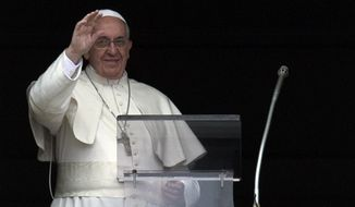 Pope Francis delivers his blessing during the Angelus noon prayer he celebrated from the window of his studio overlooking St. Peter's Square, at the Vatican,  Sunday, March 23, 2014. (AP Photo/Andrew Medichini)