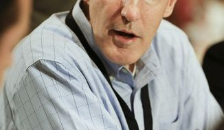 Joe Philbin, head coach of the Miami Dolphins, talks with reporters during the AFC head coaches breakfast at the NFL football annual meeting in Orlando, Fla., Tuesday, March 25, 2014. (AP Photo/John Raoux)