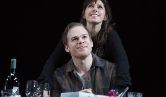 "This image released by Jeffrey Richards Associates shows Marisa Tomei and Michael C. Hall during a scene from ""The Realistic Joneses,"" at the Lyceum Theatre in New York.  (AP Photo/Jeffrey Richards Associates, Joan Marcus)"